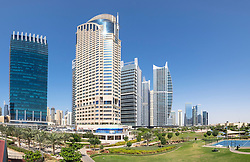 Daytime skyline view of modern high-rise office and apartment buildings at  JLT, Jumeirah Lakes Towers in Dubai United Arab Emirates