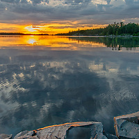 A sunset glows over Lake of the Woods, Ontario, Canada.