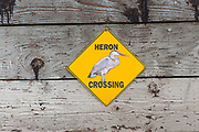 Heron Crossing sign at the Glendale Narrows on the Los Angeles River. The Narrows is one of the few places the river is not paved and is a home to many birds and wildlife. Los Angeles, California, USA