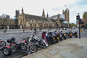 London, UK, May, 8, 2021 — British War Veterans parked their motorbikes outside Houses of Parliament, Westminster Palace during a 'Respect our Veterans' march in Parliament Square, central London on Saturday, May 8, 2021. The march follows the collapse of the controversial trial earlier this week against two paratroopers accused of murdering Official IRA leader Joe McCann in 1972. (Photo/ Vudi Xhymshiti)