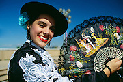 NJ, Jersey City, Liberty State Park, Spanish dancer with fan at ethnic festival.