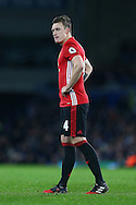 Phil Jones of Manchester United looks on. Premier league match, Everton v Manchester United at Goodison Park in Liverpool, Merseyside on Sunday 4th December 2016.<br /> pic by Chris Stading, Andrew Orchard sports photography.