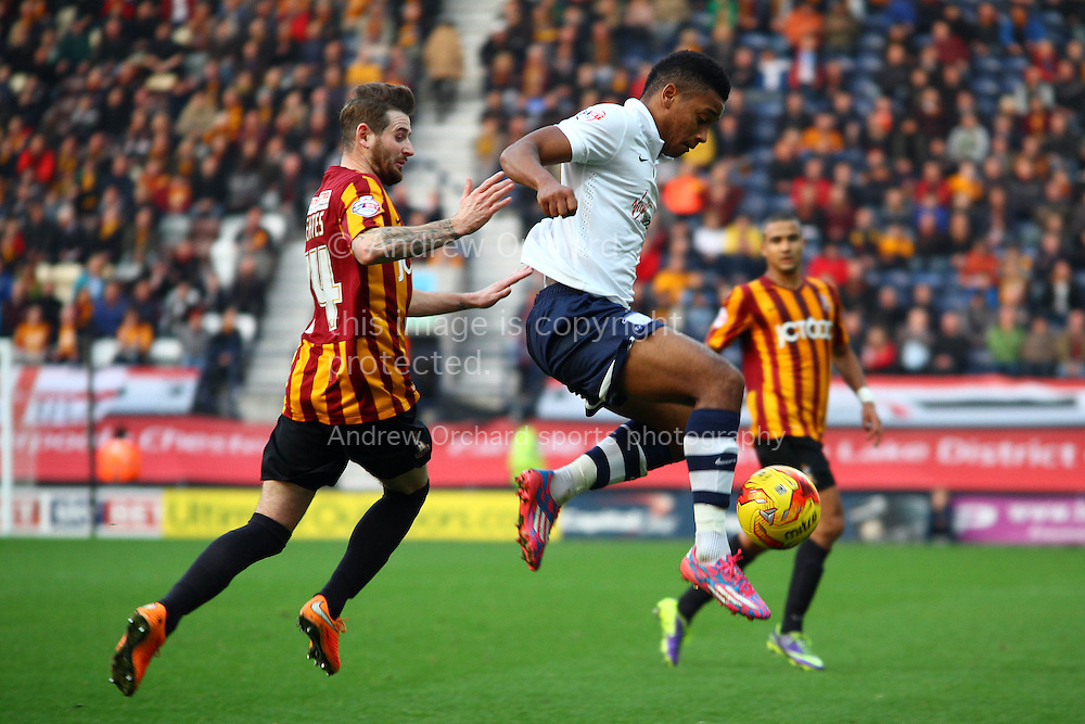 Preston North End's Chris Humphrey controls the ball under pressure from Bradford City's Mark Yeates. Skybet football league one match, Preston North End v Bradford city at Deepdale in Preston, Lancs on Saturday 15th November 2014.<br /> pic by Chris Stading, Andrew Orchard sports photography.