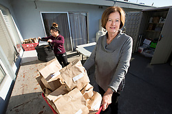 Rosemary Reilly, right, director of the Alameda Meals on Wheels chapter, assists her volunteers with their morning deliveries, Tuesday, Nov. 7, 2017 in Alameda, Calif. (Photo by D. Ross Cameron)