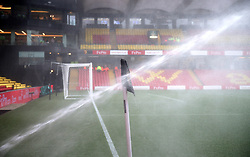 The pitch is watered before the Premier League match at Vicarage Road, Watford.