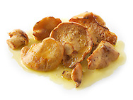 Sauteed wiild organic Pied de Mouton Mushrooms (hydnum repandum) or hedgehog mushrooms cooked in butter and herbs