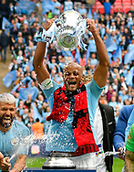 Vincent Kompany (4) of Manchester City lifts the FA Cup trophy during the The FA Cup Final match between Manchester City and Watford at Wembley Stadium, London, England on 18 May 2019.