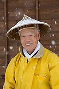 Portrait of senior man smiling at camera, Shirakawa-go, Japan