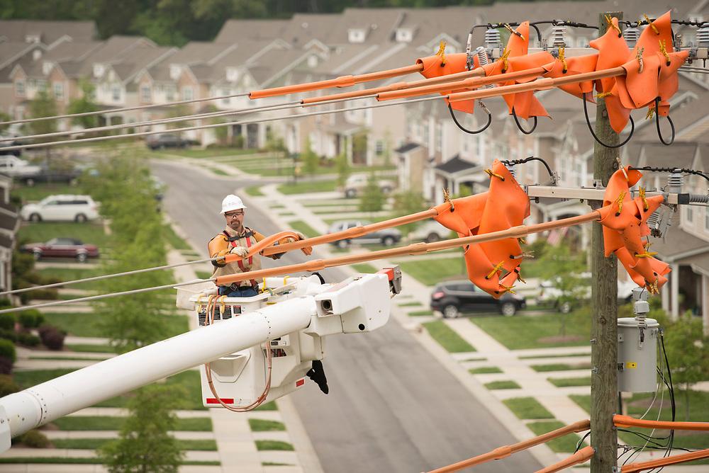 Duke Energy Lineman working in neighborhood