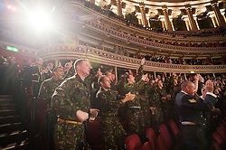 © Licensed to London News Pictures. London, UK  07/10/2011. UK Army squadron member watch a fight. Members of the UK and US Armed Forces take part in the Royal Albert Hall cup boxing match. This is the first time a boxing event has taken place in the historic venue following a court ruling banning the use of the hall for boxing and wrestling in 1999. The Court of Appeal subsequently overturned the decision earlier this year. The venue has hosted some of the greatest names in British boxing including Sir Henry Cooper, Frank Bruno, Lennox Lewis and Prince Naseem Hamed. Photo credit: Ben Cawthra/LNP
