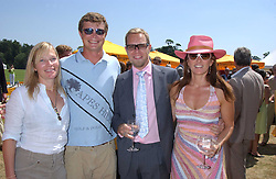 Left to right, JACK and BE KIDD and SEBASTIAN PEARSON and his wife AMANDA AUSTIN  at the Veuve Clicquot sponsored Gold Cup Final or the British Open Polo Championship held at Cowdray Park, West Sussex on 17th July 2005.<br />
