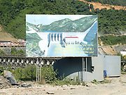 A billboard showing the finished Nam Ou Cascade Hydropower Project Dam 5, Phongsaly Province, Lao PDR. In the Nam Ou river valley the first phase of construction on the Nam Ou Cascade Hydropower Project by Chinese corporation Sinohydro has begun, the project will generate electricity, 90% of which will be exported to other countries in the region.  The project will directly affect several districts in Phongsaly province through construction, reservoir impoundment and back flooding resulting in loss of land and assets and village relocation. The 425 km long Nam Ou river is a major tributary of the Mekong and is the lifeline of rural communities and local economies.