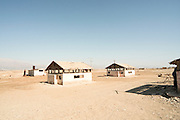 Israel, Dead Sea. Abandoned buildings on the shore