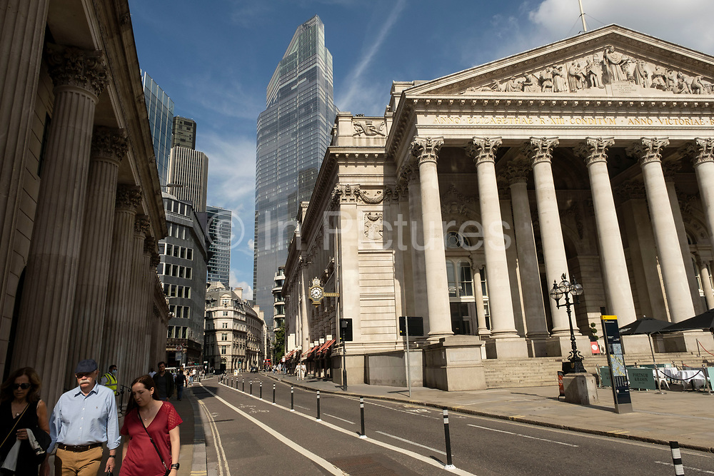 With very few people out and about the scene in the City of London financial district is one of quiet, outside the Royal Exchange near the Bank of England with 22 Bishopsgate, also known as Twentytwo, which is a new commercial skyscraper looming above the old institutional buildings as the national coronavirus lockdown eases on 2nd July 2021 in London, United Kingdom. As the coronavirus lockdown continues its process of easing restrictions, the City remains far quieter than usual, which asks the question if normal numbers of people and city workers will ever return to the Square Mile.