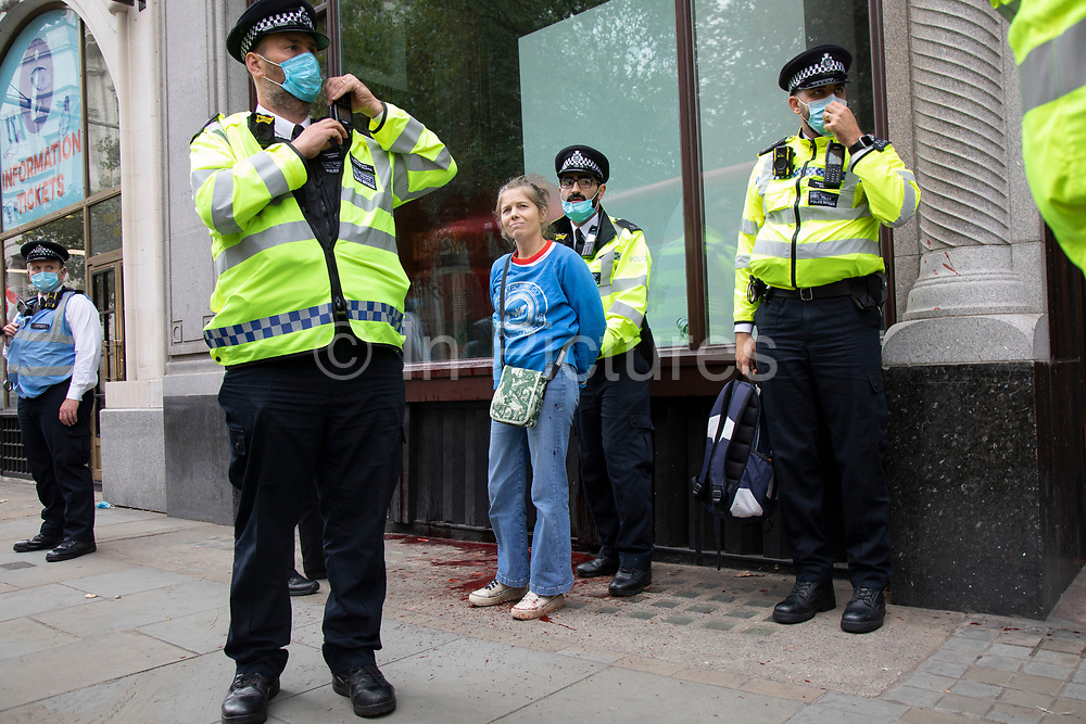 Extinction Rebellion protester is detained and handcuffed by police for throwing red paint to mimick blood onto the outside the Brazilian Embassy on 7th September 2020 in London, United Kingdom. Extinction Rebellion is a climate change group started in 2018 and has gained a huge following of people committed to peaceful protests. These protests are highlighting that the government is not doing enough to avoid catastrophic climate change and to demand the government take radical action to save the planet.