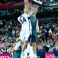 08 August 2012: USA Anthony Davis is rejected by Australia Aron Baynes during 119-86 Team USA victory over Team Australia, during the men's basketball quarter-finals, at the 02 Arena, in London, Great Britain.