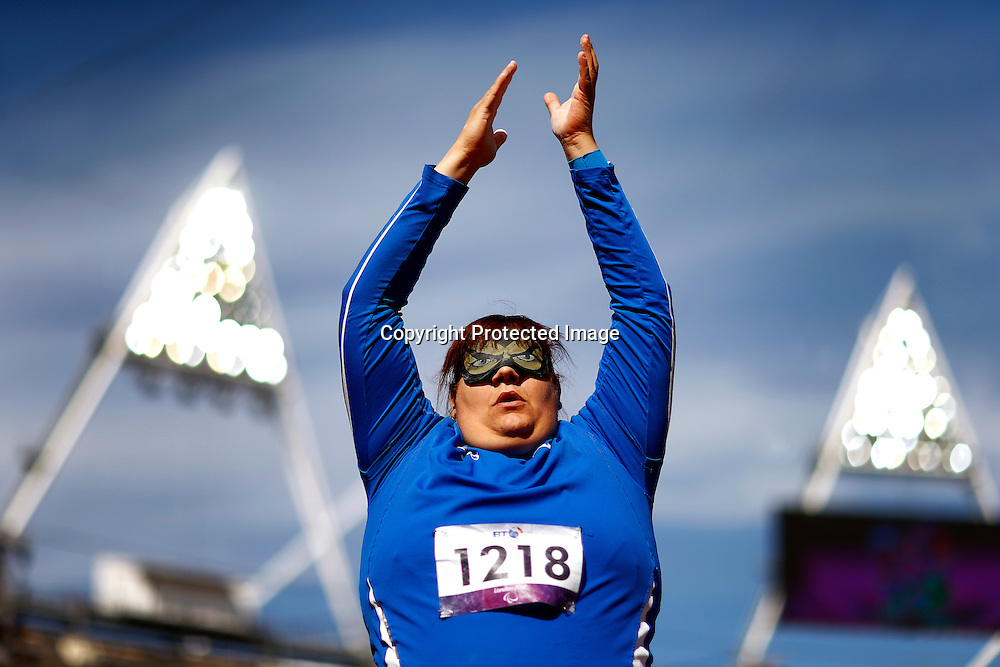 Assunta Legnante of Italy greets spectators after competing in the women's Shot Put F11/12 final at the Olympic Stadium during the London 2012 Paralympic Games in London, Britain, 05 September 2012. Legnante won the gold medal.  EPA/KERIM OKTEN
