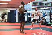 Coach Mike Winkeljohn works with UFC middleweight Derek Brunson of North Carolina between sparing rounds at Jackson Wink MMA in Albuquerque, New Mexico on June 9, 2016.