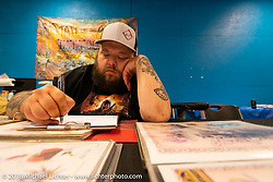 Main Street tattoo parlor during the 78th annual Sturgis Motorcycle Rally. Sturgis, SD. USA. Saturday August 11, 2018. Photography ©2018 Michael Lichter.