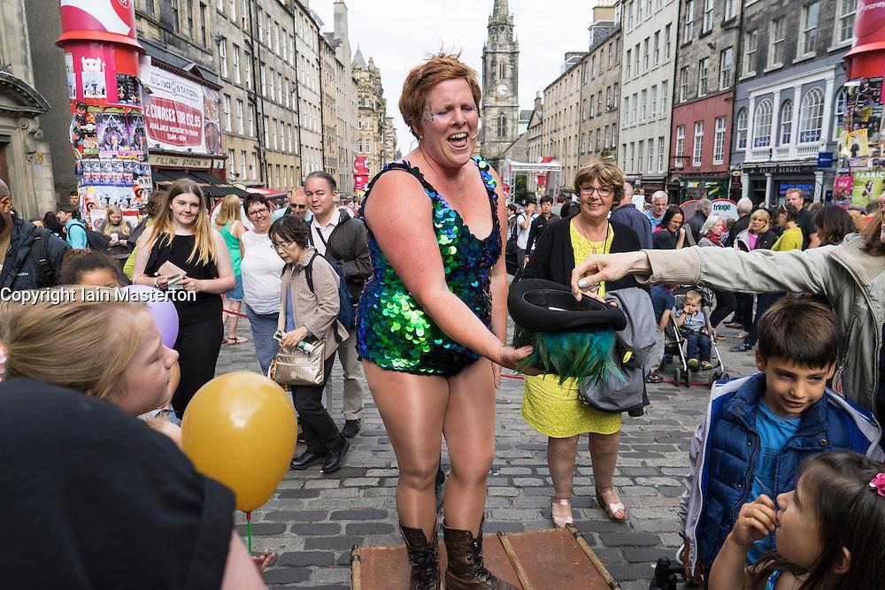 Street performer collecting donations on  High Street during Edinburgh Fringe Festival 2016 in Scotland , United Kingdom