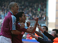 Photo: Lee Earle.<br /> West Ham United v Middlesbrough. The Barclays Premiership. 31/03/2007.United's Carlos Tevez (R) and Bobby Zamora celebrate after Tevez's second goal.