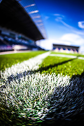 The corner flag casts a shadow on the new pitch at The Falkirk Stadium, for the Scottish Championship game v Hamilton. The woven GreenFields MX synthetic turf and the surface has been specifically designed for football with 50mm tufts compared with the longer 65mm which has been used for mixed football and rugby uses.  It is fully FFA two star compliant and conforms to rules laid out by the SPL and SFL.<br /> ©Michael Schofield.