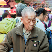 Man shopping at a street market in Hong Kong