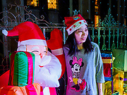 "23 DECEMBER 2018 - CHANTABURI, THAILAND: A woman poses for photos with Santa in the ""North Pole"" at the Cathedral of the Immaculate Conception's Christmas Fair in Chantaburi. Cathedral of the Immaculate Conception is holding its annual Christmas festival, this year called ""Sweet Christmas @ Chantaburi 2018"". The Cathedral is the largest Catholic church in Thailand and was founded more than 300 years ago by Vietnamese Catholics who settled in Thailand, then Siam.   PHOTO BY JACK KURTZ"