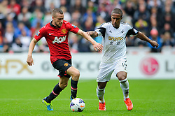 Man Utd Midfielder Tom Cleverley (ENG) is challenged by Swansea Midfielder Wayne Routledge (ENG) during the first half of the match - Photo mandatory by-line: Rogan Thomson/JMP - Tel: Mobile: 07966 386802 17/08/2013 - SPORT - FOOTBALL - Liberty Stadium, Swansea -  Swansea City V Manchester United - Barclays Premier League - First round of the 2013/14 season and the first league match for new Man Utd manager David Moyes.