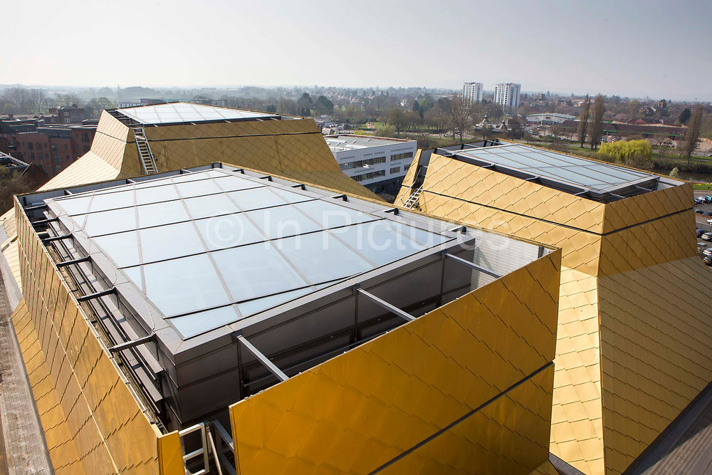 Skylights in the roof housed in the distinctive roof cones ensure natural light within the building. The Hive, Worcester is the first fully integrated university and public library in the UK. Skylights in the roof ensure natural light within the building. Worcester, UK.