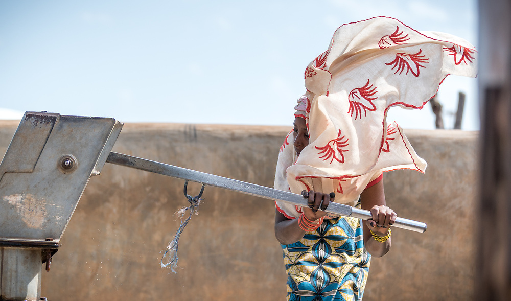 5 June 2019, Gado, Cameroon: A woman pumps water at one of the Gado refugee camps water points. Supported by the Lutheran World Federation, the Gado refugee camp in he East region of Cameroon hosts more than 25,000 refugees from neighbouring Central African Republic.