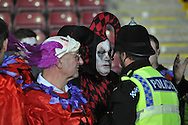 Barnsley fans dressed for halloween talk with police at end of match during the Sky Bet League 1 match between Scunthorpe United and Barnsley at Glanford Park, Scunthorpe, England on 31 October 2015. Photo by Ian Lyall.