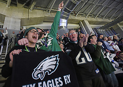 February 4, 2018 - Minneapolis, MN, USA - Diana Gonzalez and Joseph Bonner from Philadelphia celebrate after the Eagles score a touchdown in the third quarter against the New England Patriots on Sunday, Feb. 4, 2018 at U.S. Bank Stadium in Minneapolis, Minn. (Credit Image: © Aaron Lavinsky/TNS via ZUMA Wire)