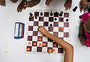Hailey Mize,15, plays blitz chess against her opponent as several girls watch during the all girls chess camp hosted by the West Louisville Chess Club at Louisville Urban League on Thursday, July 12, 2018.