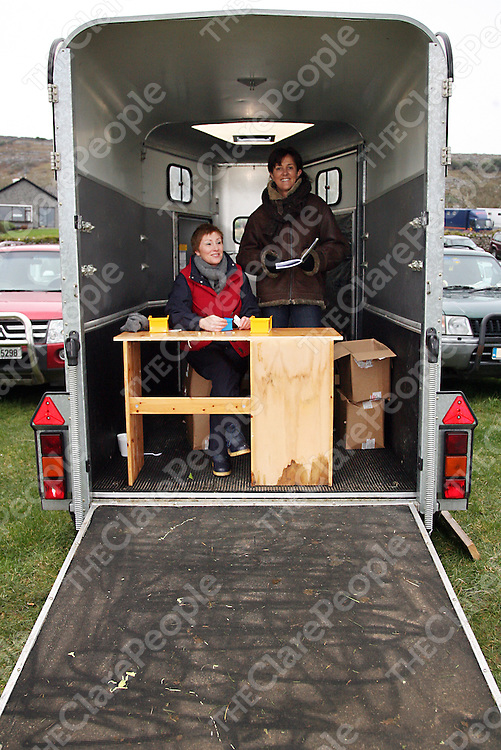 Deirdre Cusack and Ethne Murphy selling race cards at the annual point to point meeting at Belhabour on Sunday.<br /><br />Photograph by Yvonne Vaughan.