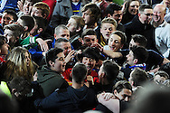 Cardiff city player Kim Bo -Kyung (in centre) is mobbed by fans as Cardiff celebrate promotion to the Premier league. NPower championship, Cardiff city v Charlton Athletic at the Cardiff city stadium in Cardiff, South Wales on Tuesday 16th April 2013. pic by Andrew Orchard,  Andrew Orchard sports photography,
