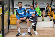 Richard Money, the Cambridge United manager and Mark Bonner, the Cambridge United Head of Player Development looking on from the dugout before k/o.Skybet football league two match, Cambridge Utd v Portsmouth at the Abbey Stadium  in Cambridge on Saturday 10th October 2015.<br /> pic by John Patrick Fletcher, Andrew Orchard sports photography.