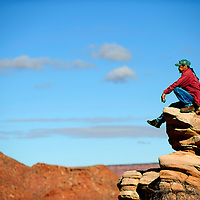 101312  Adron Gardner<br /> <br /> Willard Sandoval, of Shiprock, takes a high seat above the runners trail to watch the Zuni invitational cross country meet in Zuni Saturday.