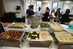 May 24, 2017 - Toronto, ON, Canada - TORONTO, ON- MAY 24  - Traditional Syrian food catered by a Syrian refugee is laid out. Guests mingle as Uber hosts a Welcome Refugee Dinner. UNICEF is launching the Welcome Refugee Dinner campaign in Canada. Toronto will play host to the first series of dinners at corporate offices and private homes to bring together refugees and non-refugees to share their life experiences to foster understanding and build communities.  in Toronto. May 24, 2017.  Steve Russell/Toronto Star (Credit Image: © Steve Russell/The Toronto Star via ZUMA Wire)
