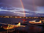 Late afternoon rainbow over Lake Hood floatplane base, Anchorage, Alaska.
