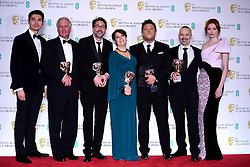 Henry Golding and Eleanor Tomlinson present John Casali, Tim Cavagin, Nina Hartstone, Paul Massey and John Warhurst with their Bafta for Best Sound for Bohemian Rhapsody in the press room at the 72nd British Academy Film Awards held at the Royal Albert Hall, Kensington Gore, Kensington, London.