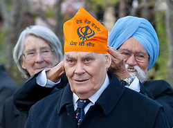 © Licensed to London News Pictures. 02/04/2019. Bristol, UK. Former Lord Lieutenant of Bristol SIR JAY TIDMARSH has a Sikh head covering put in place at the Bristol Sikh War Memorial and Remembrance Garden at the official opening in Bristol's Castle Park, to honour an estimated 83,000 Sikh soldiers who lost their lives in the First and Second World Wars, and more than 100,000 who were seriously wounded. The unveiling was performed by HRH The Duke of Kent, KG. The garden is close to the ruins of St Peter's Church and has been organised by the Bristol Sikh War Memorial Committee to be a peaceful way to remember the Sikh lives lost during the two conflicts. The idea was formed four years ago when Dilawer Singh Potiwal, the project leader of the committee, was attending a commemorative event with long-serving former Labour councillor Ron Stone, who died in 2015, and they had an idea that the Bristol Sikh community do something for their ancestors. All except the architects involved with the war memorial did so as volunteers. Photo credit: Simon Chapman/LNP