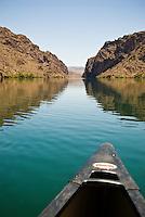 The bow of a canoe crusing through The Black Canyon, Nevada.