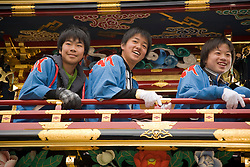 Asia, Japan, Gifu prefecture, Takayama (also known as Hida-Takayama), teenage boys  on elaborate festival float (yatai)  in Gonjunko Procession during Sanno Festival of Hie Jinja Shrine, held annually in April.