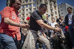 May 1, 2019 - Barcelona, Catalonia, Spain - Camil Ros (L), general secretary of UGT, and Javier Pacheco (R), secretary general CCOO in Catalonia are seen laying flowers in memory of the 82 people who died in Catalonia due to accidents at work in 2018..The two major Spanish trade unions CC.OO and UGT, accompanied by a large number of parties and social organizations have celebrated the May Day, International Workers Day with a demonstration in the streets of Barcelona under the slogan ''First people. (Credit Image: © Paco Freire/SOPA Images via ZUMA Wire)