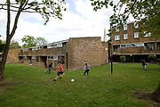 Children play football in Cressingham Gardens on 5th May 2015 in South London, United Kingdom. Cressingham Gardens is a council garden estate, located on the southern edge of Brockwell Park. It comprises of 306 dwellings and built to the design of Lambeth Borough Council architect Edward Hollamby in the early 1970s. In 2012, Lambeth Council proposed regeneration of the estate, a decision highly opposed by many residents. Since the announcement, the highly motivated campaign group Save Cressingham Gardens has been active.