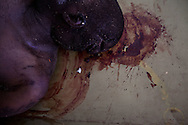 The body of an alleged foreign mercenary killed during the uprising in Benghazi on March 1, 2011.