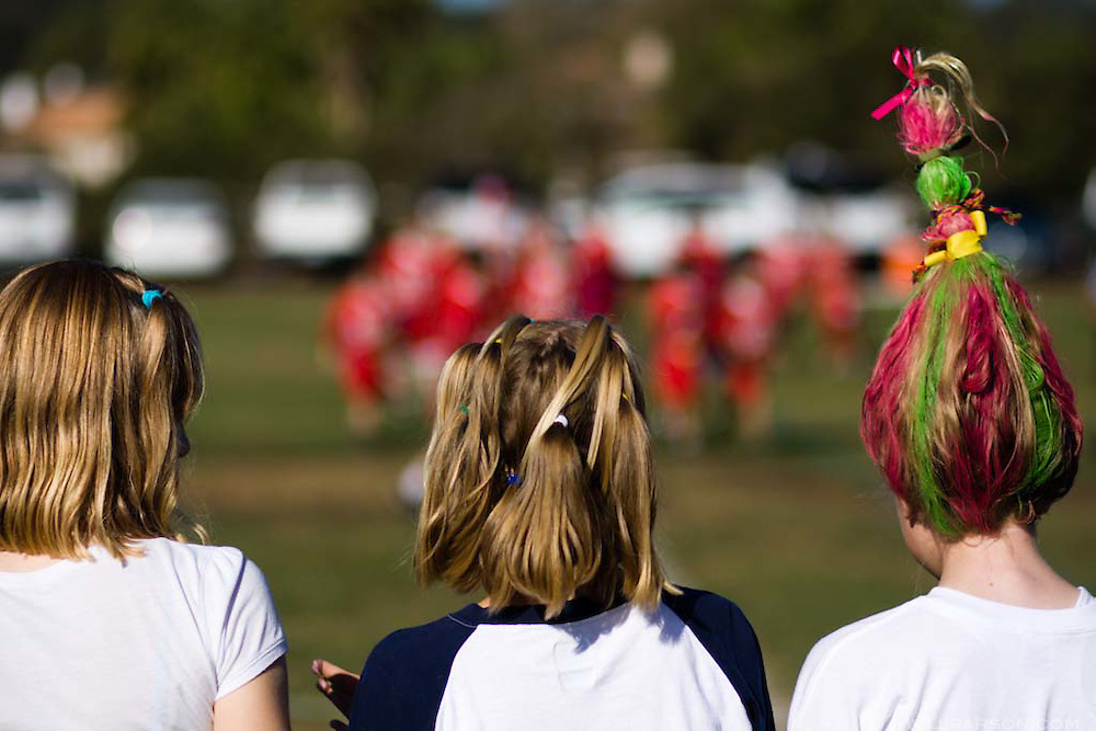 Keely Thompson, right, shows off her decorated hair while watching Horizon Prep play Santa Fe Christian during the Spirit Bowl Flag Football tournament hosted by Horizon Prep Academy on October 24, 2008 in Rancho Santa Fe.