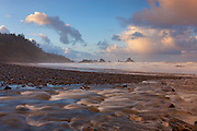 Canyon Creek flows across the Indian Beach in Ecola State Park on the Oregon coast. Several sea stacks are visible in the Pacific Ocean including Submarine Rock (left) and Sea Lion Rock Arch (right).