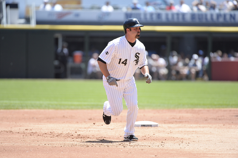 CHICAGO - JUNE 14:  Paul Konerko #14 of the Chicago White Sox runs the bases against the Kansas City Royals on June 14, 2014 at U.S. Cellular Field in Chicago, Illinois.   (Photo by Ron Vesely)